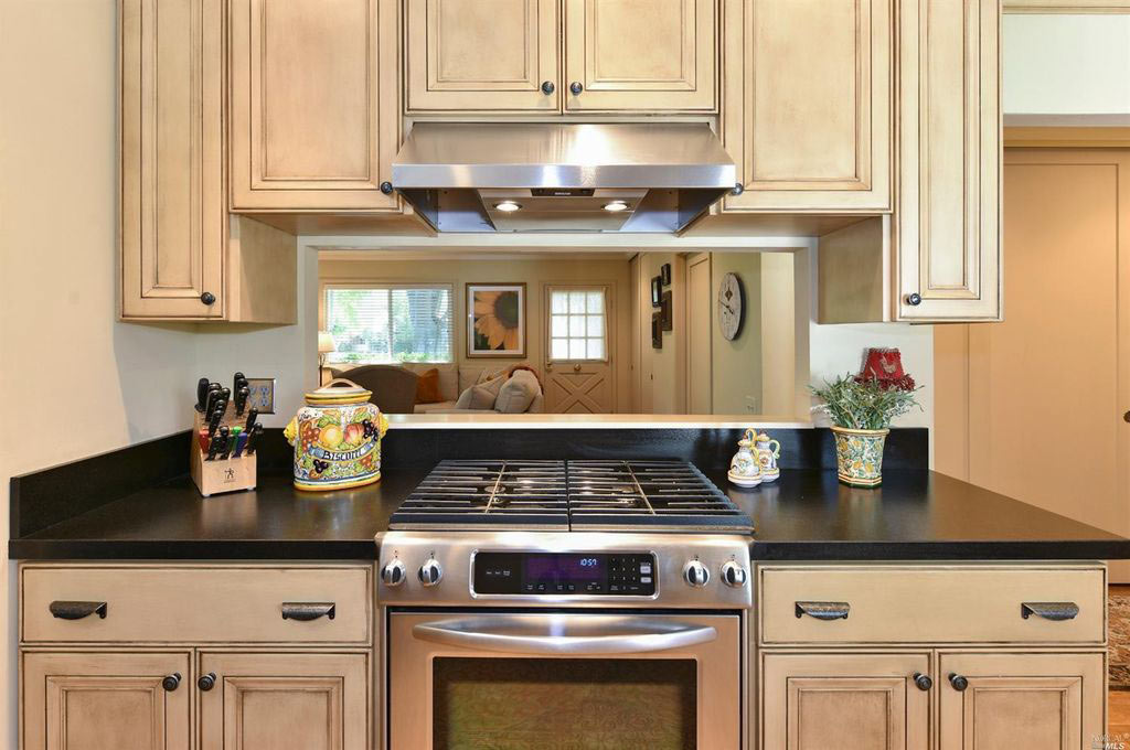 KITCHEN REMODEL WITH STAINLESS-STEEL GAS RANGE